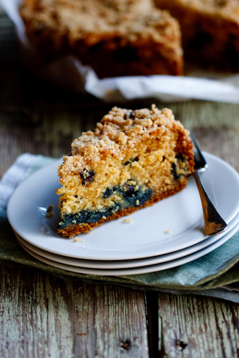A slice of blueberry crumb cake on a plate