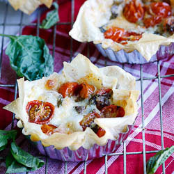 Crispy Phyllo tartlettes with Cherry tomatoes, Mozzarella & Anchovies