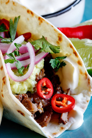 Slow-braised short rib tacos with pickled red onion