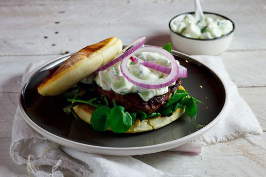 Curried Lamb burgers on naan bread with cucumber raita