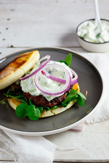 Curried Lamb burgers on naan bread with cucumber raita