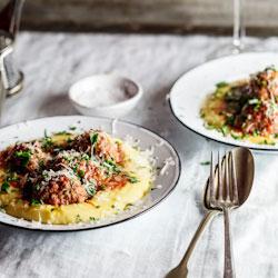Meatballs baked in tomato sauce on polenta