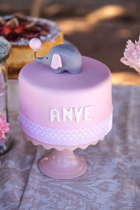 Pink elephant baby shower cake