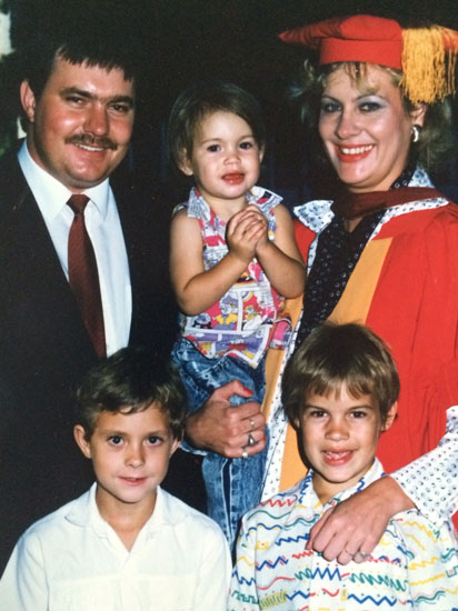 My mom (holding me), dad, brother and cousin