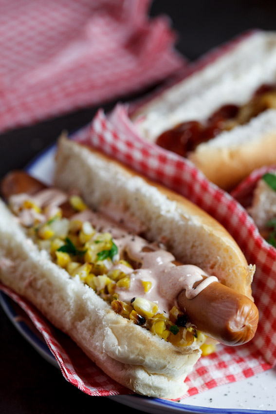 Hot dog with corn salsa & sour cream drizzle