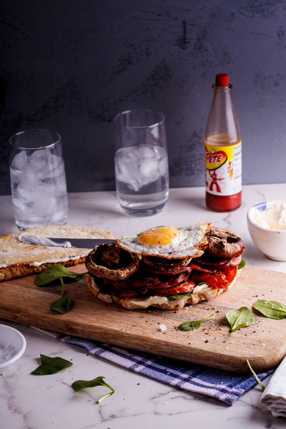 What could be better than a proper breakfast with all the trimmings on a sandwich? Not much, to be honest. These enormous sandwiches are a great way to jazz up your usual breakfast and serve it in a fun way. It's also just absolutely delicious. Every bite is filled with smoky, saltiness from the bacon, sweetness from the mushrooms and tomatoes and creaminess from the perfectly fried eggs. Along with that you get crunch from the bread and smooth from the mayo. I mean. Seriously.