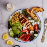 Spicy roast chicken salad with ciabatta crisps and creamy lemon dressing