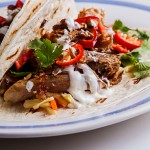 Shredded pork tacos with apple slaw