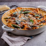 Shredded pork lasagna with smoked provolone and crispy sage