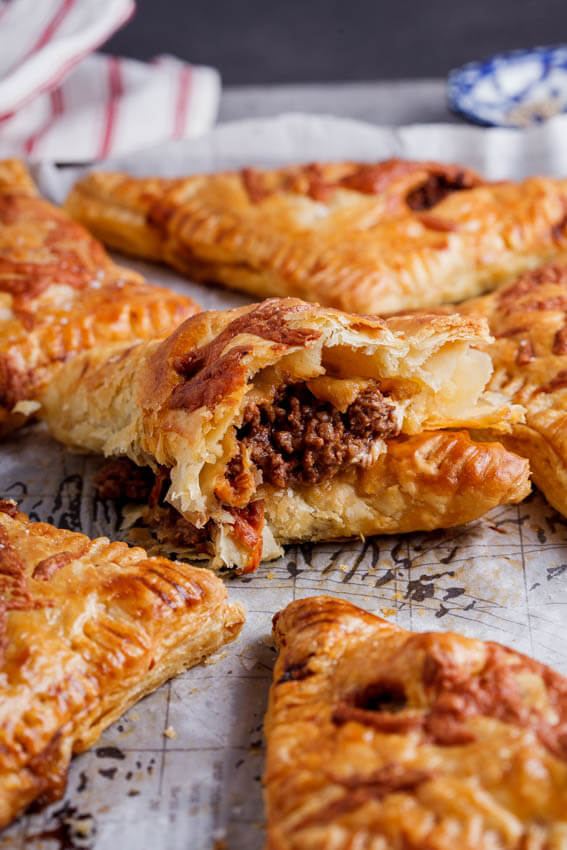 Cheesy bolognese pies
