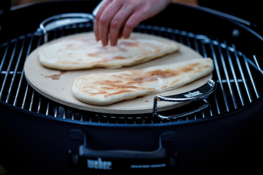 Naan bread cooking