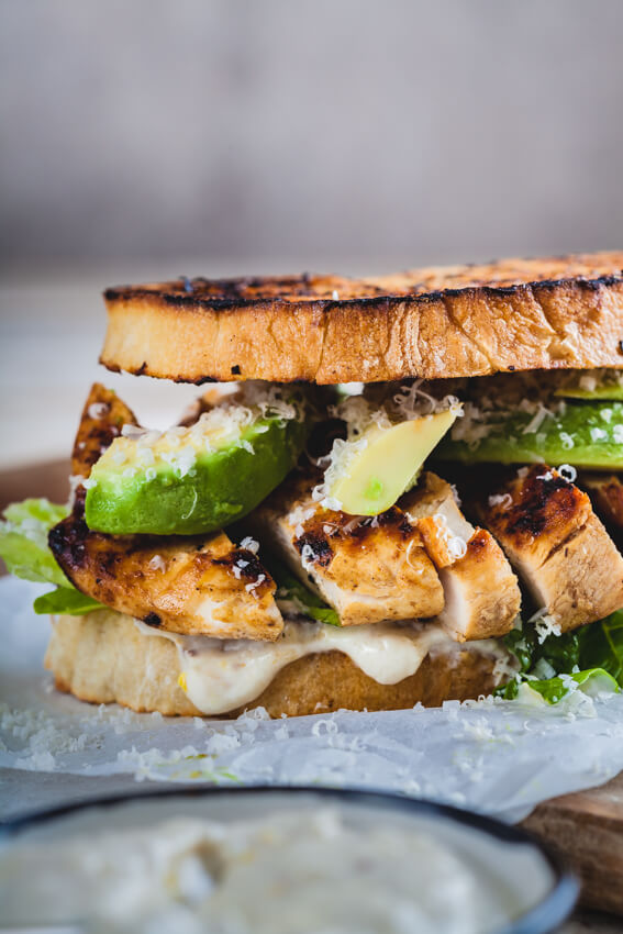 Perfect chicken Caesar sandwich with juicy grilled chicken, crisp bread and a healthier, no egg Caesar dressing that will blow your mind.