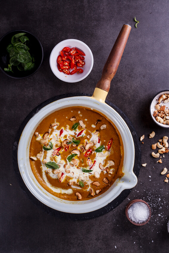 Easy and healthy vegan coconut curry pumpkin soup topped with toasted cashews and fresh chillies is a rich, satisfying and guilt-free recipe.
