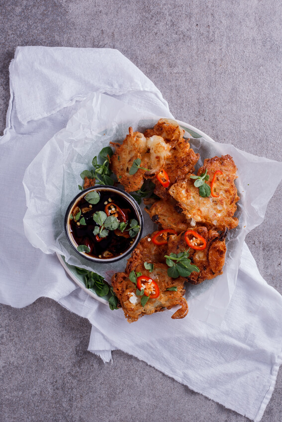 Crisp and golden onion and feta cheese fritters with sweet and spicy chilli soy dipping sauce. This recipe is perfect for a starter or as a snack.