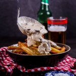French fries with creamy mushroom sauce