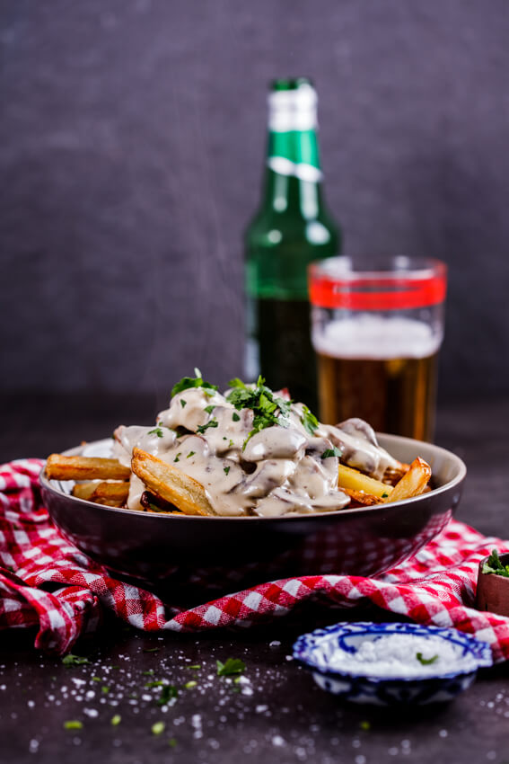 Saucy fries is the ultimate lazy, indulgent meal. Crispy oven-baked French fries topped with creamy mushroom sauce? Yes please!