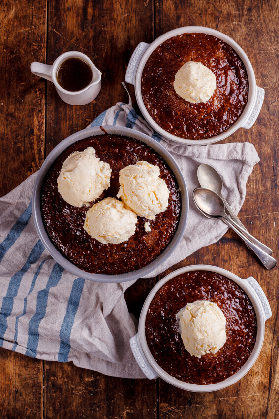 South African Malva pudding is rich, syrupy and absolutely delicious served with quick and easy frozen custard. The ultimate dessert.