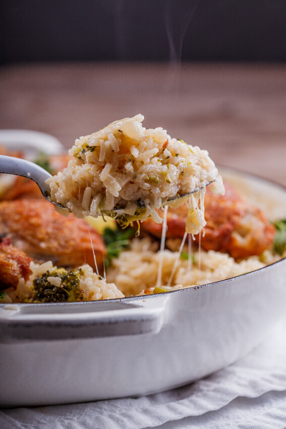 Crispy Chicken Thighs On Cheesy Broccoli Rice Simply Delicious
