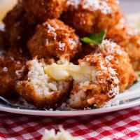 Mushroom arancini with mozzarella and roasted tomato sauce