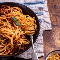 Pork bolognese with cheesy pangrattato