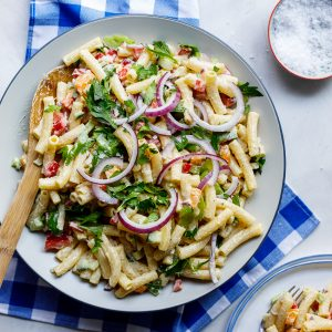 Easy creamy curried macaroni salad on blue cloth.