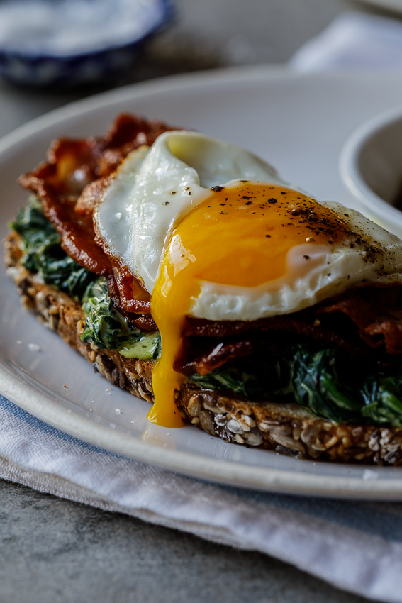 Bacon, egg and creamed spinach breakfast toast