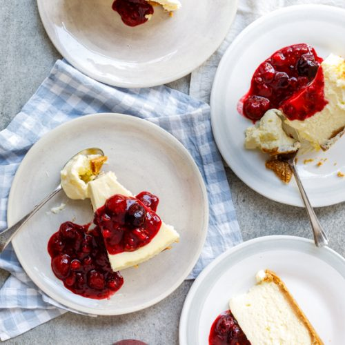 Classic baked cheesecake with easy berry sauce