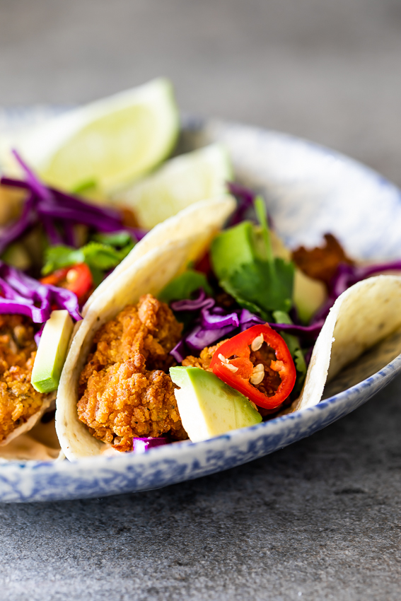 Crispy fish tacos with hot sauce crema