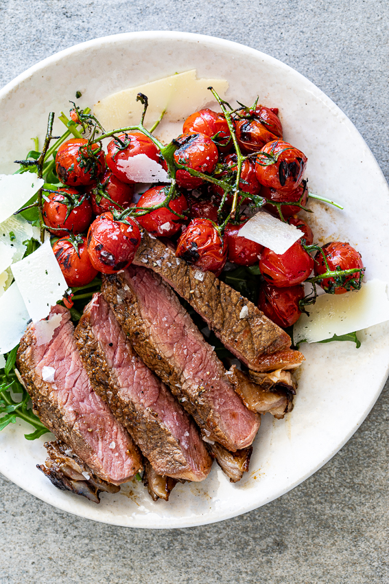 Grilled steak with blistered tomatoes