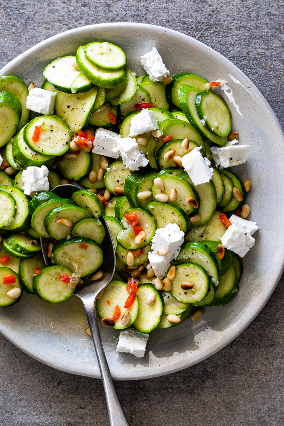 Marinated zucchini salad with feta and pine nuts