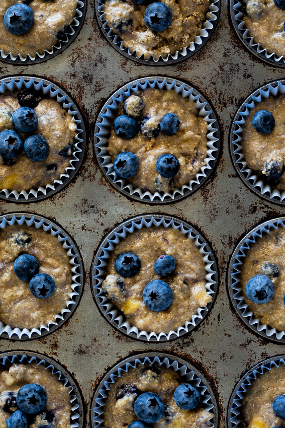 Healthy blueberry muffin batter in muffin tin