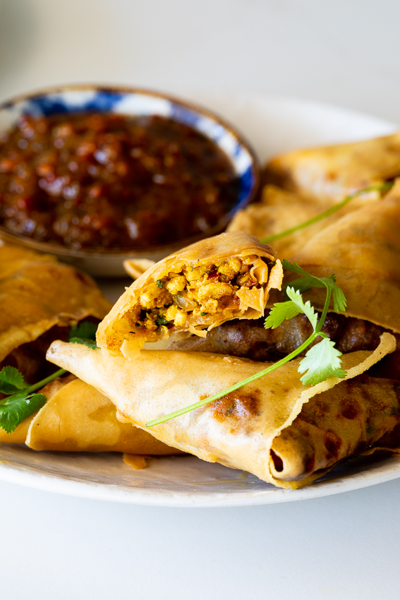 Golden fried samosas with curried chicken filling