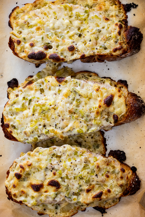 Sourdough toast topped with cheesy leek sauce.