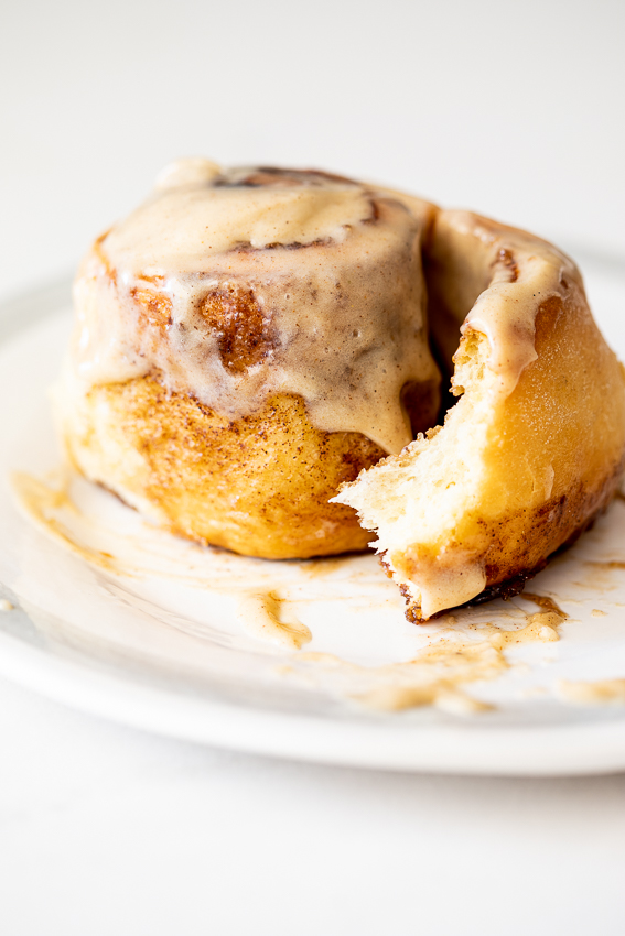 Soft and fluffy cinnamon rolls with chai icing.