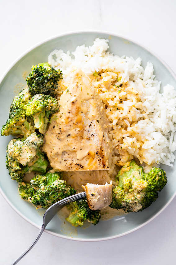 Broccoli cheddar chicken on rice.
