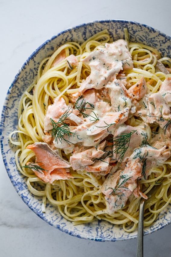 Creamy salmon pasta with fresh dill.
