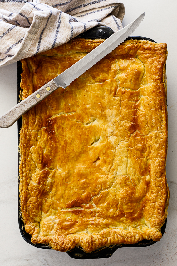 Beef pot pie topped with pastry.