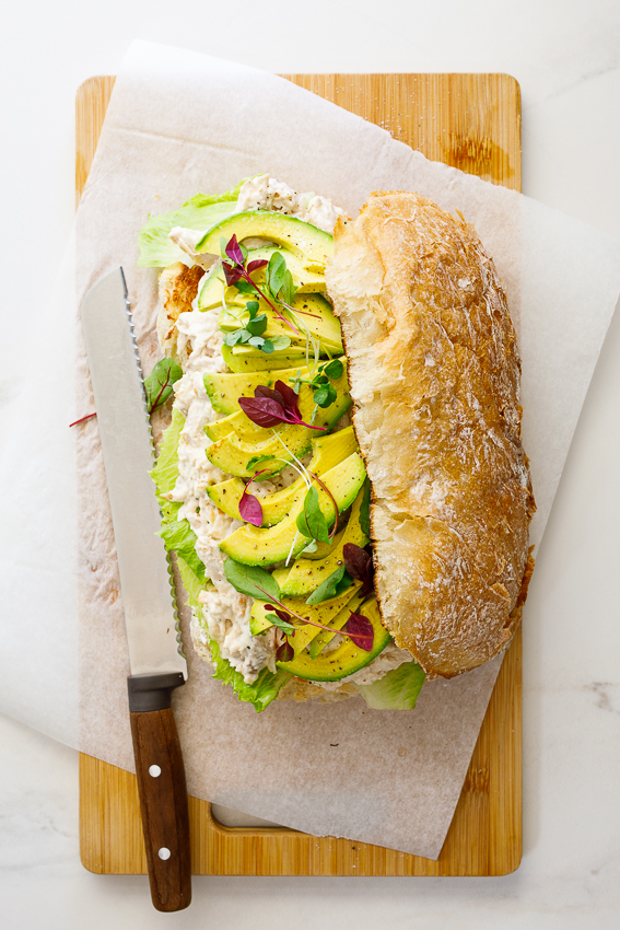 Family-size creamy chicken salad sandwich with avocado.