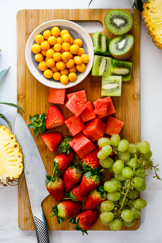 Fresh fruit on chopping board.
