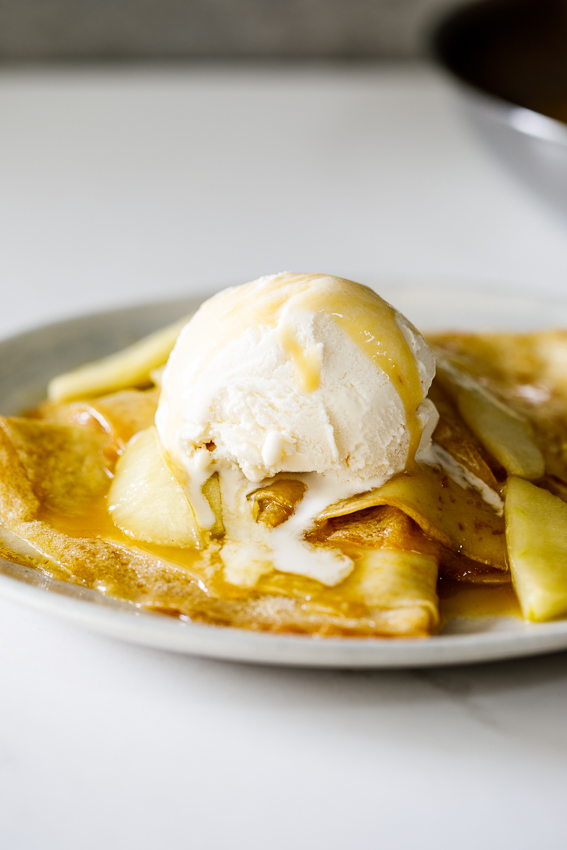 Caramelized apple crepes with ice cream.