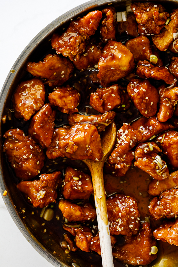 Crispy sesame chicken in sticky sauce.