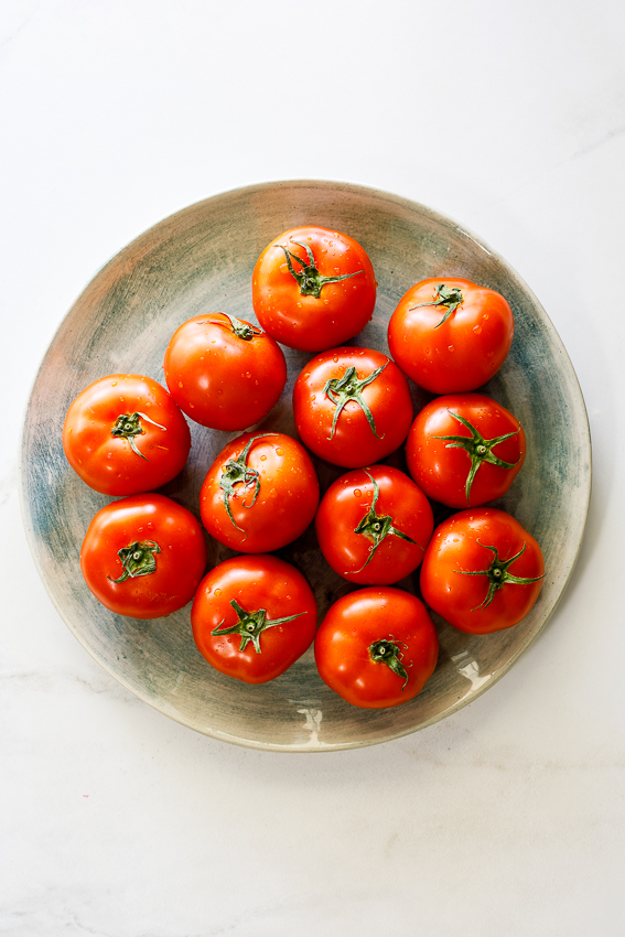 Ripe tomatoes on a plate.