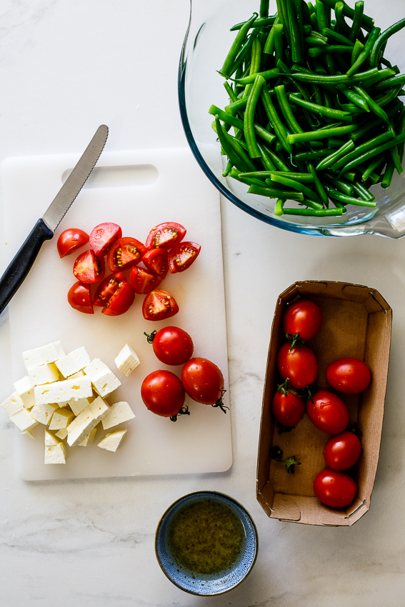 Tomatoes, feta and blanched green beans.