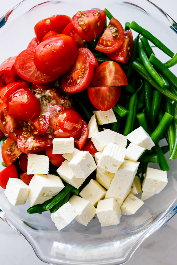Easy tomato feta green bean salad with garlic lemon vinaigrette.