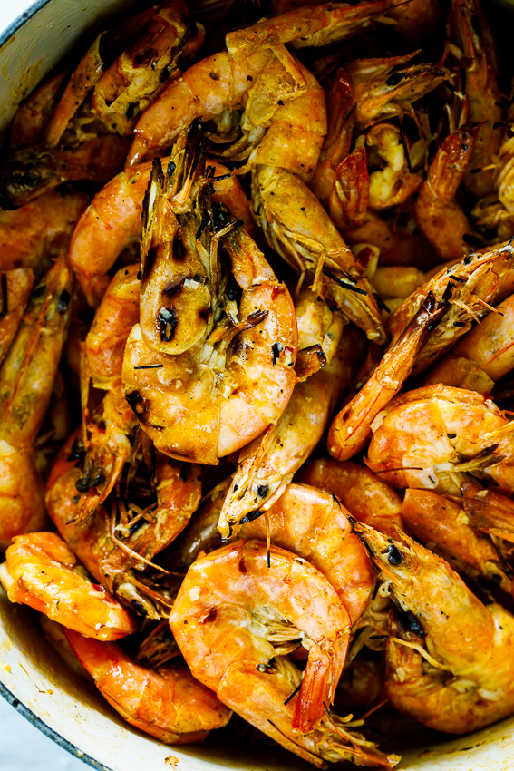 Prawns (shrimp) cooked on the grill and served with garlic butter