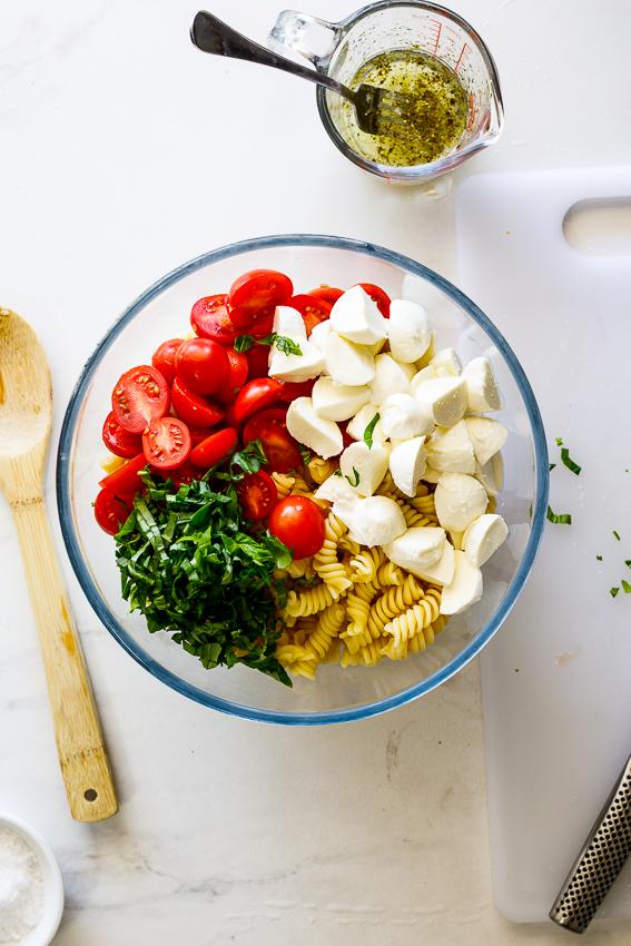 Pasta, tomatoes, mozzarella and basil.