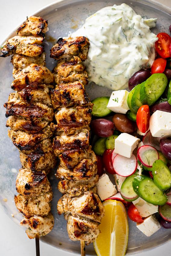 Chicken souvlaki with zucchini tzatziki with Greek salad