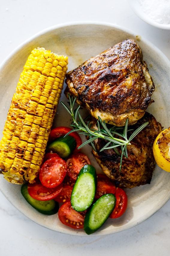 Easy grilled chicken thighs with corn and salad.