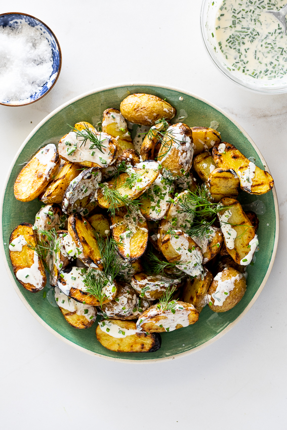 Potato salad made on the grill with sour cream dressing.