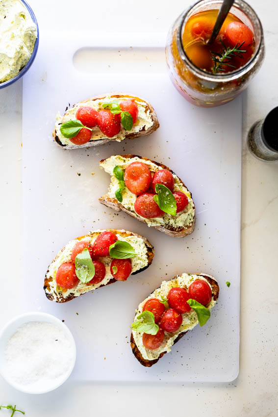 Crostini with marinated tomatoes and whipped feta